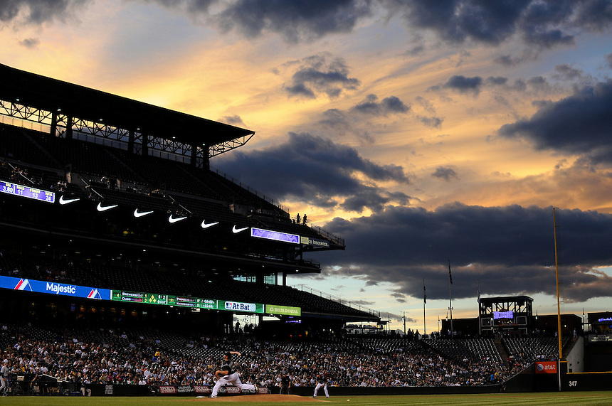 19 SEPTEMBER 2011:   The sun sets over Coors Field as Colorado Rockies starting pitcher Kevin Millwood (40) throws in this general lower view  during a regular season game between the San Diego Padres and the Colorado Rockies at Coors Field in Denver, Colorado. The Padres beat the Rockies 8-2. *****For Editorial Use Only*****
