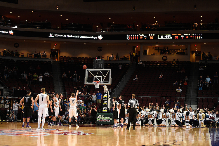 March 9, 2015; Las Vegas, NV, USA; Brigham Young Cougars guard Kyle Collinsworth (5) shoots a free throw to tie the NCAA record of six career triple-doubles against the Portland Pilots during the second half of the WCC Basketball Championships at Orleans Arena.