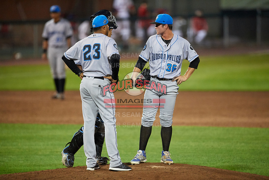 Hudson Valley Renegades relief pitcher Trey Cumbie (36) in a mound visit with pitching coach Jose Gonzalez (23) and catcher Michael Berglund (29) during a game against the Auburn Doubledays on September 5, 2018 at Falcon Park in Auburn, New York.  Hudson Valley defeated Auburn 11-5.  (Mike Janes/Four Seam Images)