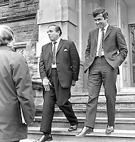 Tommy Roberts, head of the N Ireland Government Information Service, left, and Brian Cummings, private secretary to N Ireland Prime Minister, Brian Faulkner, are door-stepped by journalists as they emerge from Stormont Castle, Belfast. 18th June 1971. 197106180236.<br /> <br /> Copyright Image from Victor Patterson, 54 Dorchester Park, Belfast, UK, BT9 6RJ<br /> <br /> t1: +44 28 9066 1296 (from Rep of Ireland 048 9066 1296)<br /> t2: +44 28 9002 2446 (from Rep of Ireland 048 9002 2446)<br /> m: +44 7802 353836<br /> <br /> victorpattersonbelfast@gmail.com<br /> victorpatterson@me.com<br /> <br /> www.victorpatterson.com<br /> <br /> Please see my Terms and Conditions of Use at https://www.victorpatterson.com/page2<br /> It is IMPORTANT that you familiarise yourself with them.<br /> <br /> Images used on the Internet incur an additional cost and must be visibly watermarked i.e. © Victor Patterson within the body of the image and copyright metadata must not be deleted. Images used on the Internet have a size restriction of 4kbs and are chargeable at rates available at victorpatterson.com.<br /> <br /> This image is available only for the use of the download recipient i.e. television station, newspaper, magazine, book publisher, etc, and must not be passed on to any third party. It is also downloaded on condition that each and every usage is notified within 7 days to victorpatterson@me.com<br /> <br /> The right of Victor Patterson (or the named photographer) to be identified as the author is asserted in accordance with The Copyright Designs And Patents Act (1988). All moral rights are asserted.
