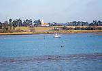 Ramsholt church and moored yacht seen from across River Deben, near Kirton Creek, Suffolk, England, UK