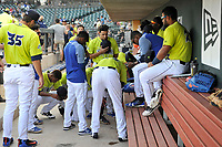 Mambers of the Columbia Fireflies gather for a prayer before a game against the Augusta GreenJackets on Friday, May 31, 2019, at Segra Park in Columbia, South Carolina. Augusta won, 8-6. (Tom Priddy/Four Seam Images)