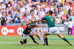 Stedman Gans (L) and Muller du Plessis of South Africa (R) put a tackle of Ben Howard of England (C) during the HSBC Hong Kong Sevens 2018 match between South Africa and England on April 7, 2018 in Hong Kong, Hong Kong. Photo by Marcio Rodrigo Machado / Power Sport Images