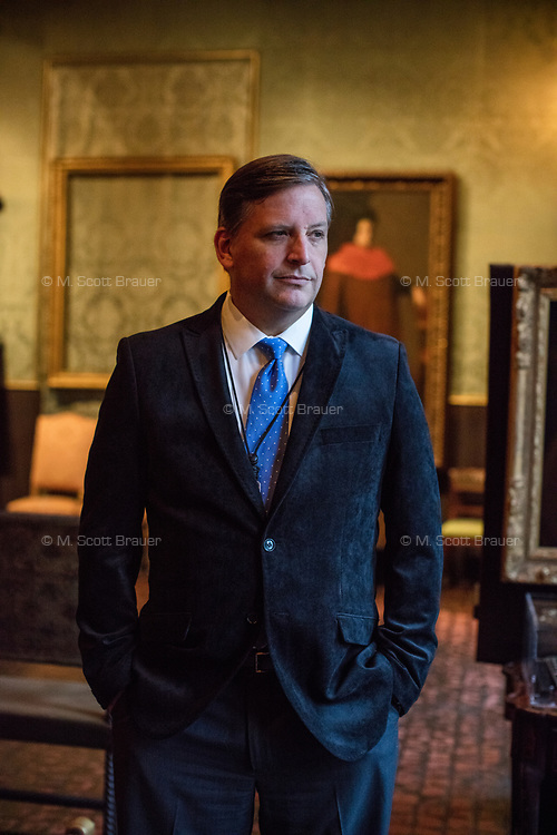 """Anthony Amore is the Directory of Security and Chief Investigator at the Isabella Stewart Gardner Museum in Boston, Mass., USA, seen here in The Dutch Room at the museum on Tues., Dec. 5, 2017. Part of Amore's ongoing work is the investigation into the 1990 theft of 13 pieces from the museum: 10 paintings, 2 objects, and 1 etching. Among the paintings stolen were works by Rembrandt, Vermeer, Degas, and Manet. The large empty frame on the wall is what held Rembrandt's """"The Storm on the Sea of Galilee"""" painting until it was stolen from the museum in the heist. At right is another empty frame, which held Vermeer's """"The Concert"""" until it, too, was stolen."""