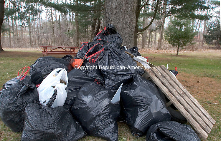 WOODBURY, CT - 07 APRIL 2007 - 040707JW16.jpg -- Plastic bags filled with trash start piling up at Hollow Park during the town of Woodburys annual spring townwide cleanup Saturday morning. Jonathan Wilcox Republican-American