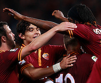 Calcio, Serie A: Roma vs Milan. Roma, stadio Olimpico, 25 aprile 2014.<br /> AS Roma forward Gervinho, of Ivory Coast, right, celebrates with teammates after scoring during the Italian Serie A football match between AS Roma and AC Milan at Rome's Olympic stadium, 25 April 2014.<br /> UPDATE IMAGES PRESS/Isabella Bonotto