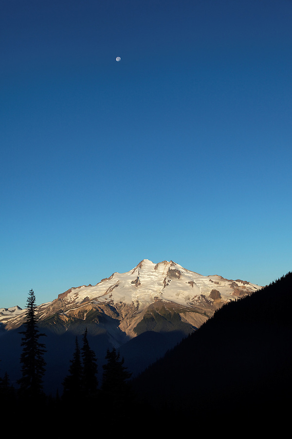 Moon over Glacier Peak viewed from Buck Creek Pass, Cascade Mountains, Snohomish County, Washington