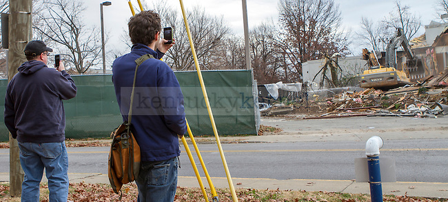 Graduate Student Keaton Hall (Right) takes a picture with his cell phone as demolition gets underway on the Joe B. Hall Wildcat Lodge Monday morning. in Lexington, Ky., on Monday, November, 26, 2012. Photo by James Holt | Staff