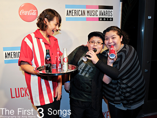 "Actor Rico Rodriguez, from the Fox television series ""Modern Family"", attends the 2010 ""American Music Awards"" Pre-Party Charity Bowl Tournament hosted by Dick Clark Productions at Lucky Strike in Los Angeles, California.  Rodriguez is pictured with his sister, actress Raini Rodriguez."