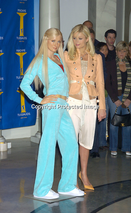 """Paris Hilton and her Wax Figure..at Madame Tussauds to reveal Paris Hilton's Wax Figure with the Cast of """"House of Wax"""" on May 2, 2005 . ..Photo by Robin Platzer, Twin Images"""