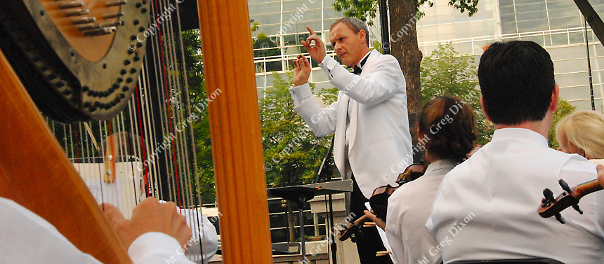 Conductor Andrew Sewell prepares the Wisconsin Chamber Orchestra for Concerts on the Square with a dress rehearsal Monday on the Capitol steps