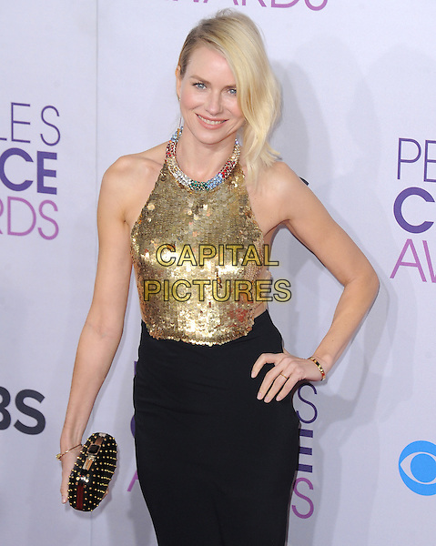 Naomi Watts.The 2013 People's Choice Awards held at Nokia Live in Los Angeles, California 9th January 2013                                                                   .half length gold sleeveless sequins sequined collar embellished jewel halterneck encrusted top skirt black clutch bag hand on hip.CAP/DVS.©DVS/Capital Pictures.