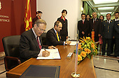 United States Secretary of Defense Donald H. Rumsfeld (left) and Macedonian Minister of Defense Vlado Buckovsk sign a Weapons of Mass Destruction agreement in Skopje, Macedonia, on October 11, 2004.  Rumsfeld is in Skopje to attend a bi-lateral meeting with Macedonia officials.   <br /> Mandatory Credit: James M. Bowman / DoD via CNP