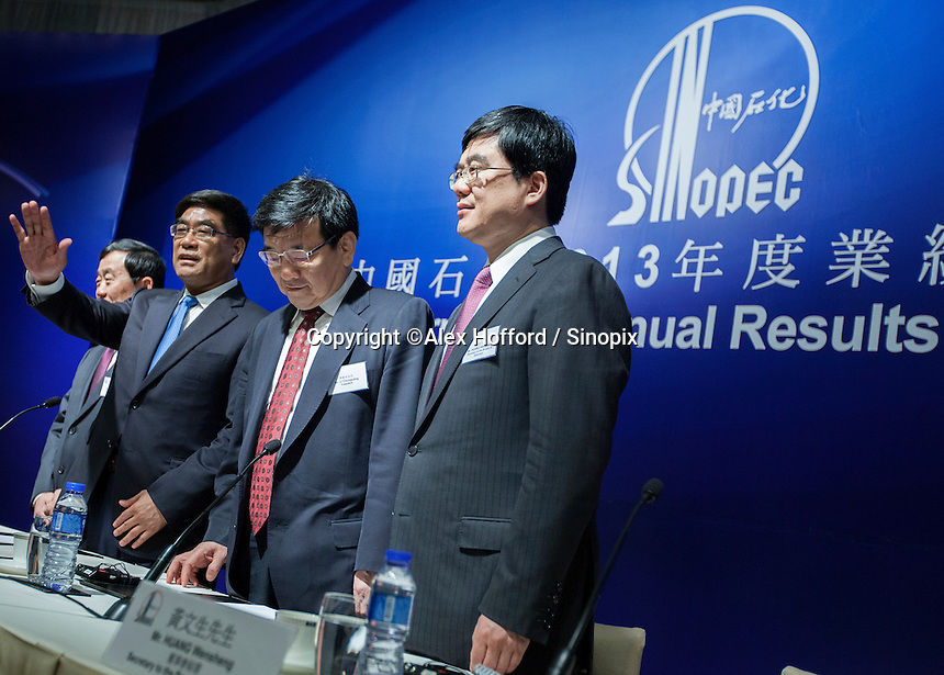"China Petroleum & Chemical Corporation (Sinopec) Chief Financial Officer Wang Xinhua (2L), Chaiman Fu Chengyu (L), President Li Chunguang (R) and Huang Wensheng, Secretary to the Board of Directors (2R), are seen at a press conference to announce the company's annual financial results for the year ended 31 December 2013, Hong Kong, China, 24 March 2014. Sinopec, China's largest upstream refiner of oil and natural gas, announced that profits rose in 2013. The company said it recorded steady growth in 2013 despite sluggishness in the domestic and global economies. The company announced a profit attributable to equity shareholders of the company was CNY 66.1 billion (Euro 7.74 billion), up 3.5% year-on-year, with revenue up 3.4 per cent thanks to ""stable"" domestic demand."