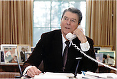 United States President Ronald Reagan addresses the 15th Annual March for Life by telephone hook-up from the Oval Office of the White House in Washington, D.C. on Friday, January 22, 1988.  The President talked with Nellie Gray..Mandatory Credit: Susan Biddle - White House via CNP