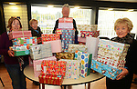 Babushka boxes for Belarus – (from left) Vera Flood, Joan McEvoy, Dave Turner and Isobel San Roma with boxes that have been donated at the Drogheda and District Support 4 Older People offices at The Haymarket.