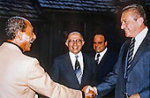 President Anwar al-Sadat of Egypt, left, shakes hands with Defense Minister Ezer Weizman of Israel, right, as Prime Minister Menachem Begin of Israel, center, looks on at Camp David, the US presidential retreat near Thurmont, Maryland during their summit to forge a peace agreement. An unidentified member of the Israeli delegation looks on from right center..Credit: White House via CNP