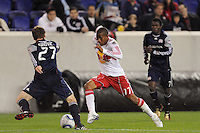 Jeremy Hall (17) of the New York Red Bulls is marked by Seth Sinovic (27) of the New England Revolution. The New York Red Bulls defeated the New England Revolution 3-0 during a U. S. Open Cup qualifier round match at Red Bull Arena in Harrison, NJ, on May 12, 2010.
