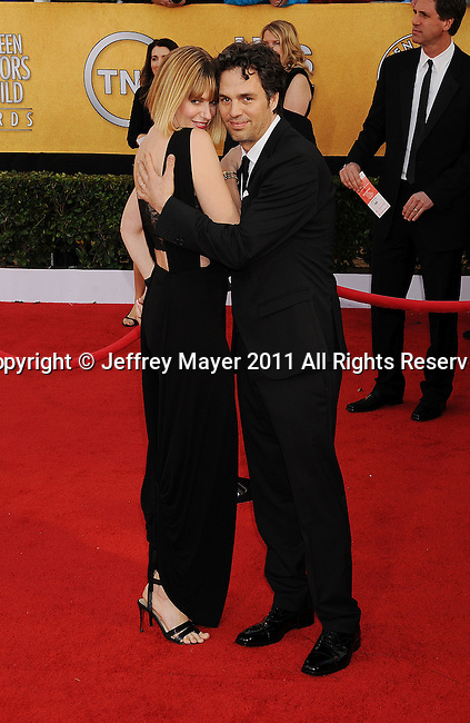 LOS ANGELES, CA - January 30: Mark Ruffalo (R) and wife Sunrise Coigney arrive at the 17th Annual Screen Actors Guild Awards held at The Shrine Auditorium on January 30, 2011 in Los Angeles, California.