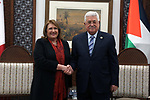 Palestinian President Mahmoud Abbas shakes hands with Malta's President Marie-Louise Coleiro Preca, in the West Bank city Ramallah, on January 31, 2019. Photo by Ahmad Arouri