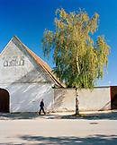 AUSTRIA, Morbisch, man walks his dog in the town of Morbisch, Burgenland