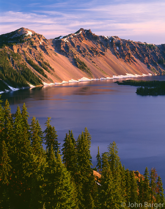 ORCL_063 - USA, Oregon, Crater Lake National Park, Sunrise on west rim of Crater Lake with The Watchman (left) and Hillman Peak (center) overlooking Wizard Island.