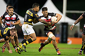 Sam Henwood muscls his way past Te Toiroa Tahuriorangi. Mitre 10 Cup rugby game between Counties Manukau Steelers and Taranaki Bulls, played at Navigation Homes Stadium, Pukekohe on Saturday August 10th 2019. Taranaki won the game 34 - 29 after leading 29 - 19 at halftime.<br /> Photo by Richard Spranger.