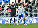 KILMARNOCK'S MANUEL PASCALI AND RANGERS' ALLAN MCGREGOR CHECK WITH THE LINESMAN TO SEE IF THE GOAL WAS OFFSIDE BEFORE PASCALI SETS OFF ON HIS CELEBRATIONS