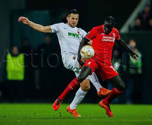 18.02.2016. Augsburg, Germany. UEFA Europa League football. Augsburg versus Liverpool FC.  Raul Bobadilla (FC Augsburg 25) Mamadou Sakho (FC Liverpool 17)