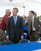 Jerry York (BC - Head Coach) shakes hands with Jack Connolly (UMD). - The members of the Hobey Hat Trick joined the Boston College Eagles and Ferris State Bulldogs at an autograph signing at Channelside Bay Plaza on Friday, April 6, 2012, in Tampa, Florida.