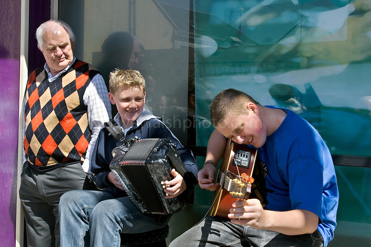 Young buskers at the Willy Clancy Festival, Miltown Malbay, Co. Clare. The festival runs for over a week every July..