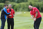 Ex Ryder Cup Captain Bernard Gallagher and Chris Hollins look on as Scott Quinnell chips onto the 9th green.<br /> <br /> Celebrity Cup Golf<br /> Celtic Manor Resort<br /> 04.07.14<br /> &copy;Steve Pope-SPORTINGWALES