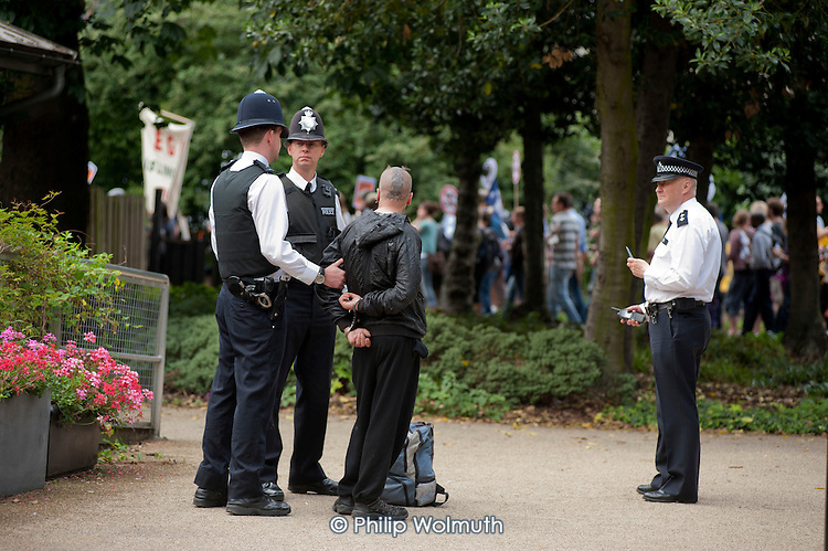 Police arrest a Black Bloc anarchist in Lincoln's Inn Fields before a demonstration by striking public sector worker over planned pension changes.