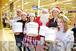 HELPING HAND: Phil Dowling, Lorraine Lynch, Siobhan Dowling, Santa, Siobhan O'Mahony and Grace Costello who gave up their time on Tuesday to bagpack in Tesco Manor West Shopping Centre for the Palliative Care Unit in KGH.