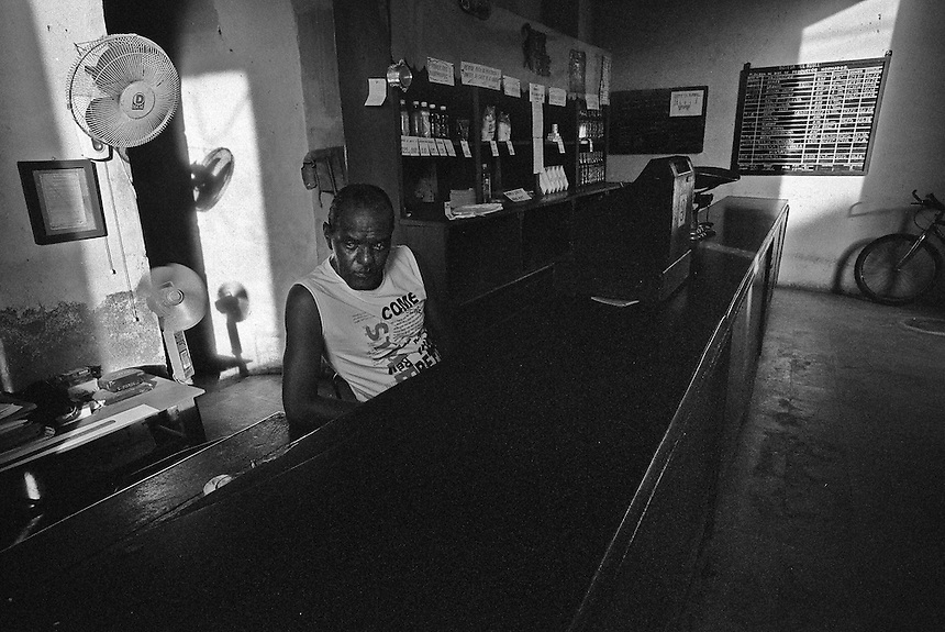 A man works in a bodega in Trinidad, Cuba. MARK TAYLOR GALLERY