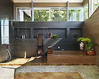 The spacious Japanese-style bathroom is more like a home-spa with a large shower and deep cast-concrete tub
