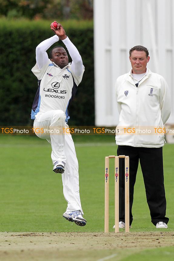 Donovan Miller of Woodford Wells - Woodford Wells CC (fielding) vs Loughton CC - Essex Cricket League - 25/06/11 - MANDATORY CREDIT: Gavin Ellis/TGSPHOTO - Self billing applies where appropriate - Tel: 0845 094 6026
