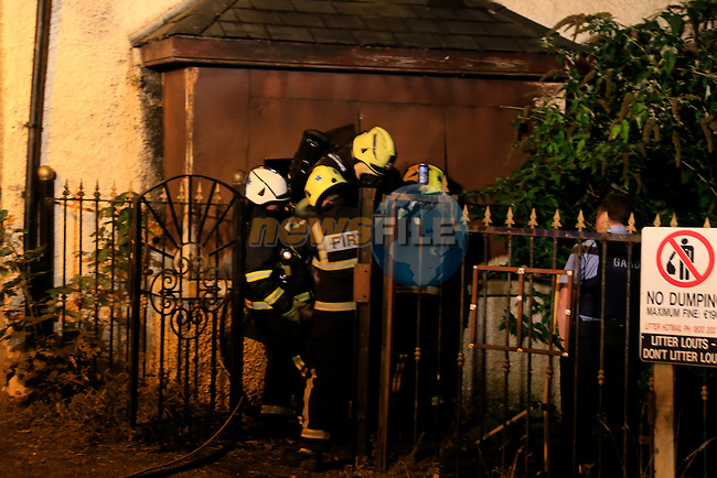 A fire in the derelict former B&amp;B off trinity Street on Thursday 24/9/15 Two units of the Drogheda fire service attended the scene.<br /> Picture Fran Caffrey /Newsfile.ie