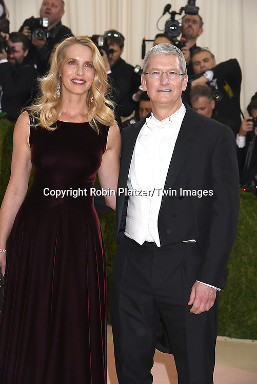 Tim Cook and Steve Jobs wife Laurene Powell Jobs  attend the Metropolitan Museum of Art Costume Institute Benefit Gala on May 2, 2016 in New York, New York, USA. The show is Manus x Machina: Fashion in an Age of Technology. <br />