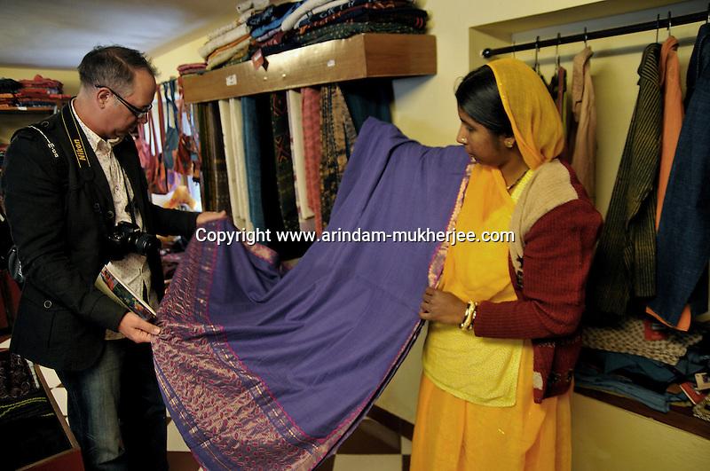 "Mr. Mark Kayen, Director of visual maketing(North America) of Olsen checking a garment during his visit to the showroom of ""Sadhna"" in Udaipur, Rajasthan, India. 24.1.2011. Arindam Mukherjee"