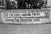 Graffiti written by squatters occupying Greater London Council properties in Elgin Avenue, Paddington, London.