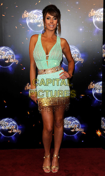 ALEX JONES.'Strictly Come Dancing' Launch Event at BBC Studios, London, England..September 7th 2011.full length blue dress cleavage hand on hip gold tassels .CAP/FIN.©Steve Finn/Capital Pictures.