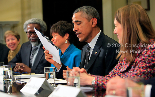 United States President Barack Obama meets with members of the President's Council of Advisors on Science and Technology in the Roosevelt Room of the White House in Washington, DC on March 27, 2015. From left to right: James Gates, Valerie Jarrett, POTUS, Silvia Mathews Burwell.<br /> Credit: Dennis Brack / Pool via CNP