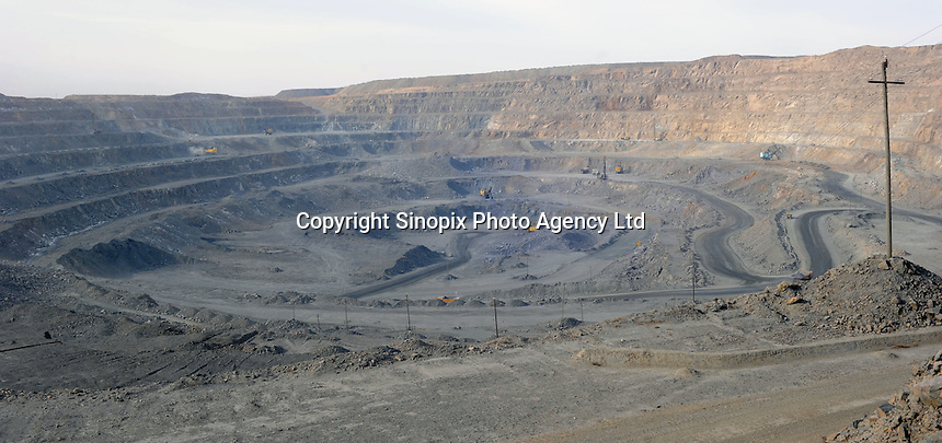 "Baotau Steel Rare Earth open cast mines at Bayan Obo, Inner Mongolia. The two mile wide craters produce some 77% of the Rare Earth produced. China produces accounts for some 97% of rare earth consumed world-wide. The ""rare earth elements"" are a group of 17 elements that are essential in 25% of modern technology including cell phones, computer hard discs, and electric motors and inparticular green technology such as electric batteries and wind turbines.  China yesterday, 23 September 2010, stopped trading rare earth with Japan, who rely on Chinese imports for its high tech industry,  over a territorial dispute. .FILE PHOTO-DEC 2009"