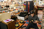 Jason Austin, also known as dj PopNoir Soundsystem, shops for one dollar 7-inch vinyl records at Antone's record shop in Austin, Texas. Austin hosts the South by Southwest Music Festival and is home to notable record stores that continue to stock, buy and sell vinyl records enriching its homegrown music scene.  (Photo by Ben Sklar for the New York Times)