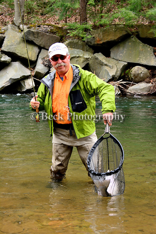 Happy angler with a big rainbow trout, Chuck Furinsky