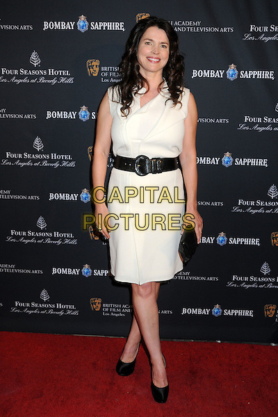 JULIA ORMOND .17th Annual BAFTA Los Angeles Awards Season Tea Party held at the Four Seasons Hotel, Beverly Hills, California, USA, 15th January 2011..full length dress black white belt shoes platform clutch bag  cream white .CAP/ADM/BP.©Byron Purvis/AdMedia/Capital Pictures.