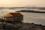 Cabanes de pecheur de l ile de Rost sous la lumiere du soleil de minuit. photo prise &agrave; 2h du matin fin juin<br /> on distingue de droite &agrave; gauche &nbsp;l ile de&nbsp;V&aelig;roy, de Mosken et la pointe sud de Moskenes.<br /> <br /> Fisherman cabins on the Rost island under the midnight sun light. Picture taken at 2 am end of june