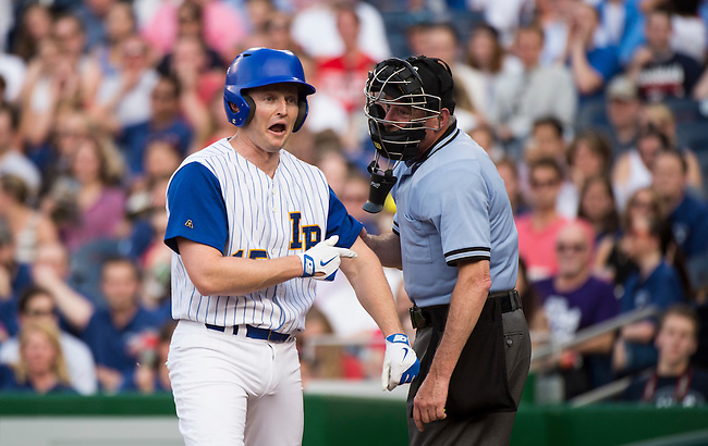 UNITED STATES - JUNE 11: Rep. Patrick Murphy, D-Fla., tries to convince the umpire he was hit by a pitch during the 54th Annual Roll Call Congressional Baseball Game at Nationals Park in Washington on Thursday, June 11, 2015. The Democrats beat the Republicans 5-2. (Photo By Bill Clark/CQ Roll Call)