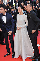 CANNES, FRANCE. May 25, 2019: Xu Qing & Huang Jue  at the Closing Gala premiere of the 72nd Festival de Cannes.<br /> Picture: Paul Smith / Featureflash